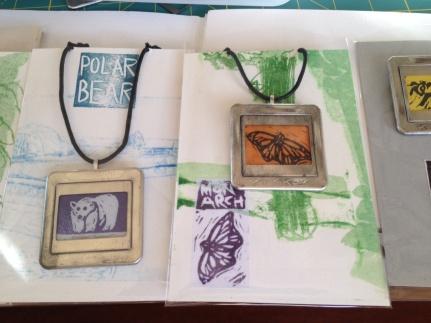 Polar bear and monarch necklaces