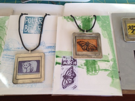 Polar bear and monarch necklaces